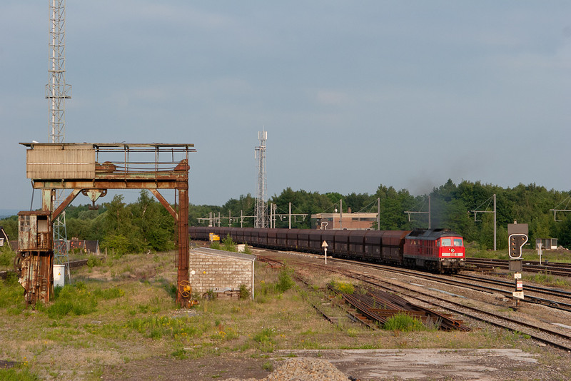 A rare view unlikely to be repeated. 241 803 has an empty coal train in tow as it passes between Block 16 (still operating) and the old customs yard in Montzen in June 2007. The L39 from Welkenraedt is already electrified to provide an alternate route for ICE and Thalys trains detouring due to construction on the L37 for a very brief time. The entire catenary visible in this view was used by less than 20 trains before it was scrapped again when the interlocking was rebuilt in 2008.