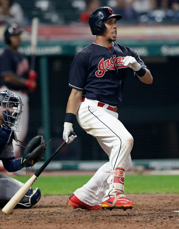 . Cleveland Indians\' Michael Brantley watches his ball after hitting a single in the eighth inning of a baseball game against the Minnesota Twins, Tuesday, Aug. 7, 2018, in Cleveland. (AP Photo/Tony Dejak)