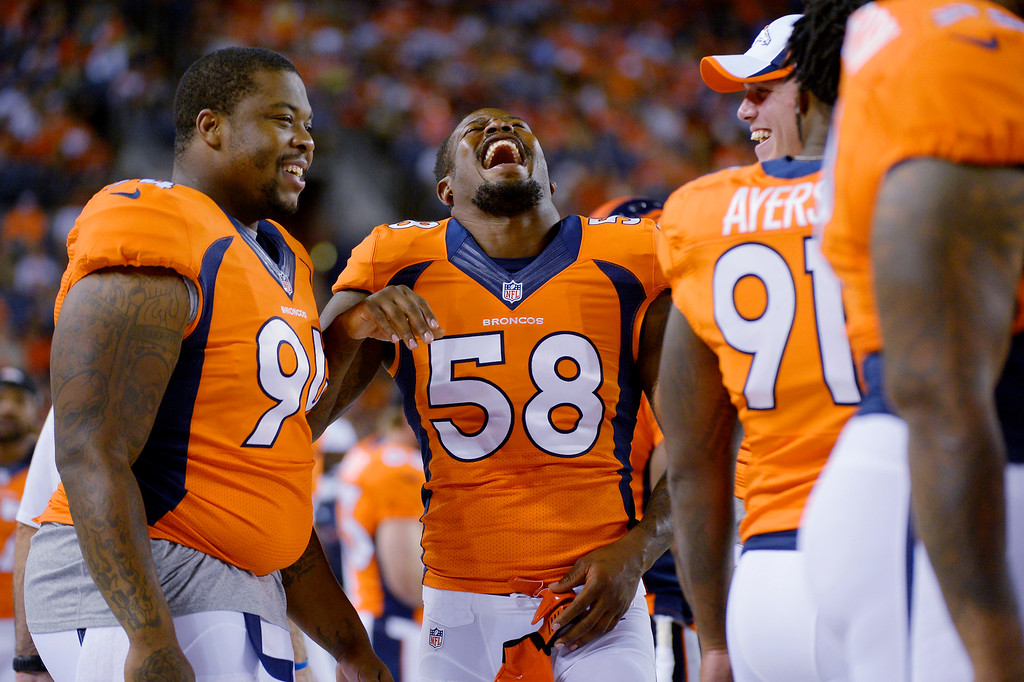 . August 29: Von Miller (58) of the Denver Broncos jokes with teammates on the sidelines during the last pre-season game of the season at Sports Authority Field at Mile High. August 29, 2013 Denver, Colorado. (Photo By Joe Amon/The Denver Post)