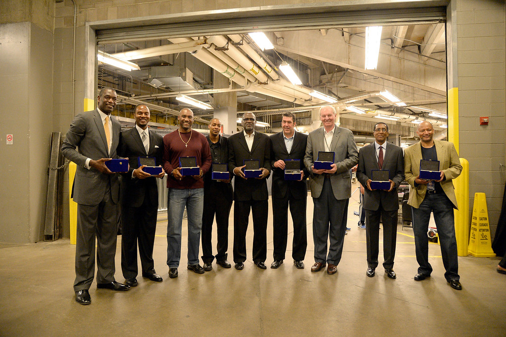 . Dikembe Mutombo , LaPhonso Ellis, Tom Hammonds, Darnell Mee, Reggie Williams, Mark Randall, Dan Issel, Gene Little and Mike Evans pass for a photo March 17, 2014 at Pepsi Center. The Denver Nuggets celebrated after nearly 20 years since the 1993-94 Denver Nuggets shocked the sports world by becoming the first-ever 8th seed to best a one-seed in a NBA Playoff series. (Photo by John Leyba/The Denver Post)