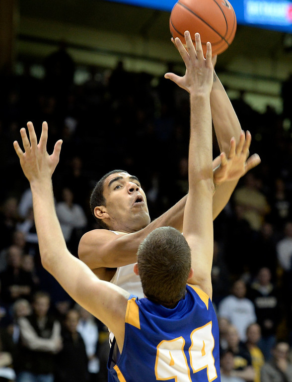 . University of Colorado\'s Josh Scott takes a shot over Sam Beeler during a game against  the University of California Santa Barbara, on Nov. 20, at the Coors Event Center in Boulder.  (Jeremy Papasso/Boulder Daily Camera)