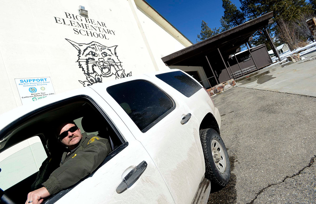 . San Bernardino County Sheriff Deputy Shannon Deasey is posted outside of  Big Bear Elementary School in Big Bear Lake February 11, 2013.  Sheriff\'s Department have stationed deputies outside the schools in the local area.  After four days of active searching, authorities has drastically reduced the manhunt for Christopher Dorner in the Big Bear area.    GABRIEL LUIS ACOSTA/STAFF PHOTOGRAPHER.