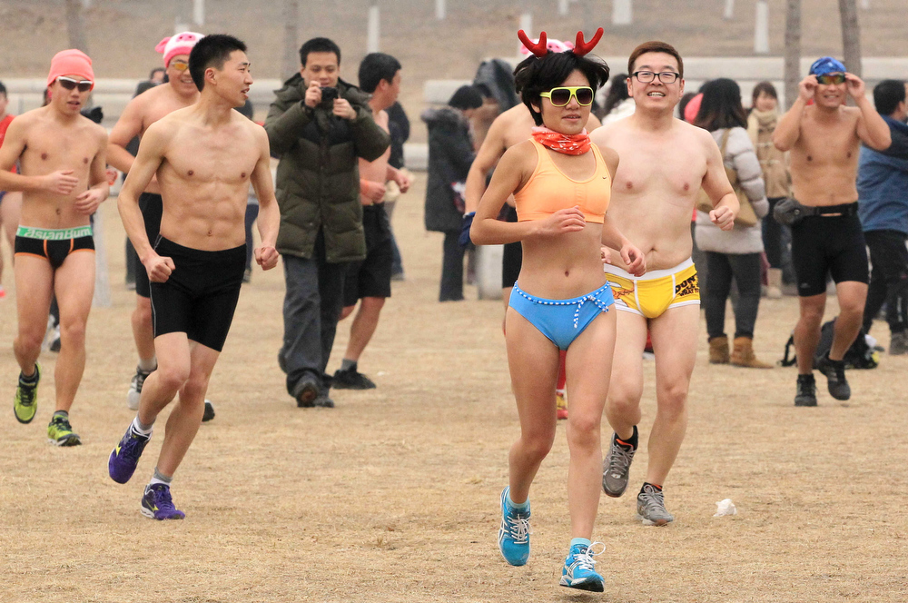 Description of . This picture taken on February 24, 2013 shows paticipants taking part in the annual 3.5 km Undie Run held in the Olympic Forest Park in Beijing. Some 300 participants wanted to prove that Chinese can brave the cold just as well as any nationality and promote nationwide fitness. There were no winners, no trophies and no starting gun or finishing line.  AFP PHOTOAFP/AFP/Getty Images