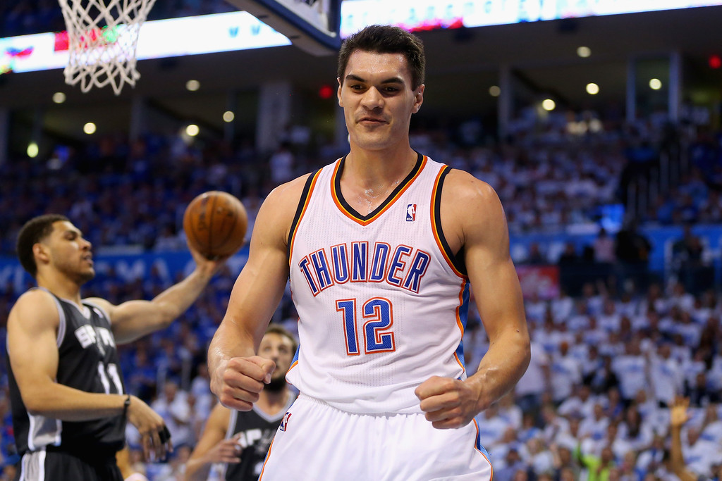 . OKLAHOMA CITY, OK - MAY 27: Steven Adams #12 of the Oklahoma City Thunder reacts after a play in the second half against the San Antonio Spurs during Game Four of the Western Conference Finals of the 2014 NBA Playoffs at Chesapeake Energy Arena on May 27, 2014 in Oklahoma City, Oklahoma. (Photo by Ronald Martinez/Getty Images)