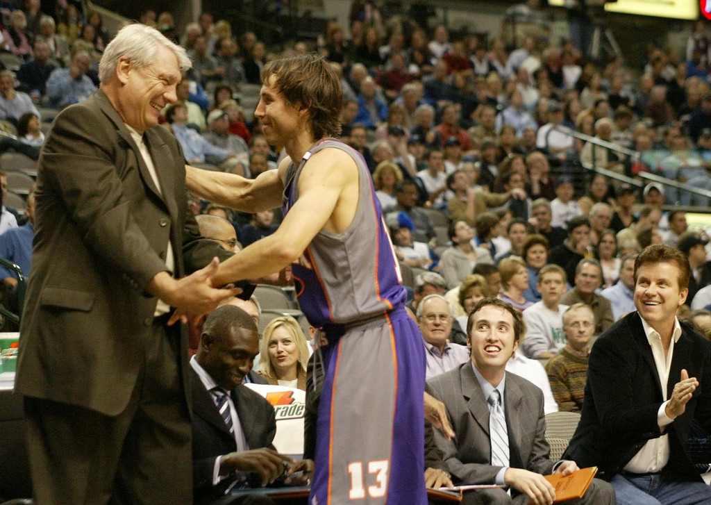 . Former Dallas Mavericks guard and current Phoenix Suns guard Steve Nash, right, from Canada gives Dallas Mavericks coach Don Nelson a hug before the start of their game in Dallas, Tuesday, Nov. 16, 2004.   (AP Photo/Donna McWilliam)