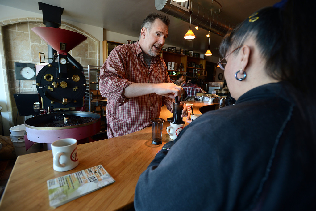 . Catahoula Coffee Company owner Tim Manhart makes a fresh cup of coffee for Ginger Sanchez, of Richmond, at the coffee shop in Richmond, Calif. on Thursday, Jan. 17, 2013. (Kristopher Skinner/Staff)