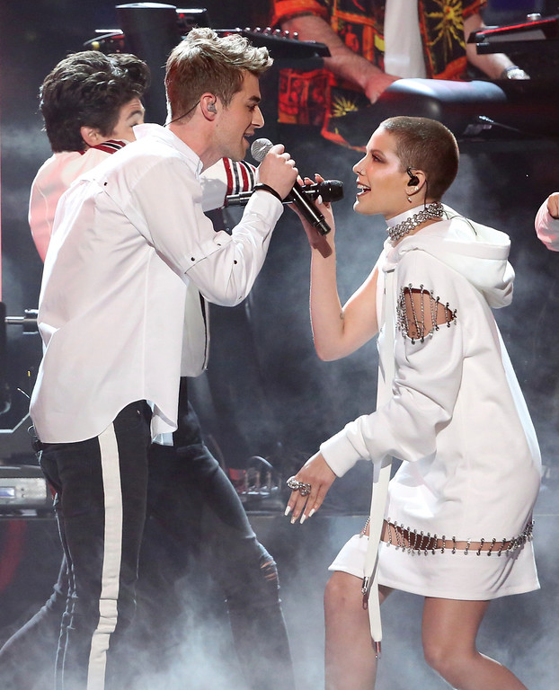 ". Andrew Taggart, left, of The Chainsmokers, and Halsey perform ""Closer\"" at the American Music Awards at the Microsoft Theater on Sunday, Nov. 20, 2016, in Los Angeles. (Photo by Matt Sayles/Invision/AP)"