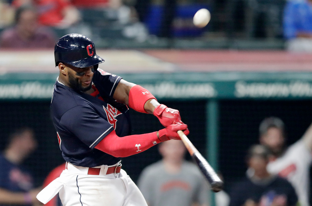 . Cleveland Indians\' Yandy Diaz hits an RBI triple off Kansas City Royals relief pitcher Brandon Maurer in the seventh inning of a baseball game, Tuesday, Sept. 4, 2018, in Cleveland. Rajai Davis scored on the play. (AP Photo/Tony Dejak)