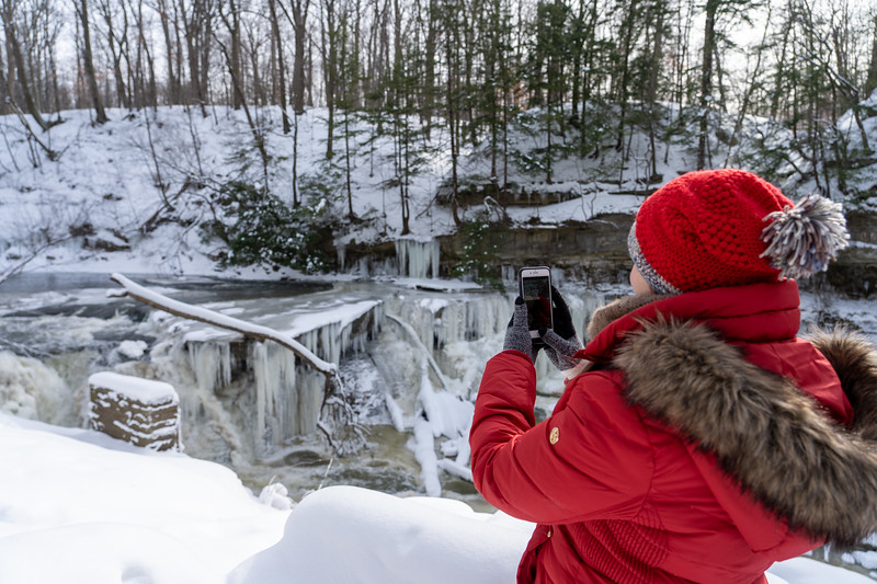 Taking photos of a frozen waterfall