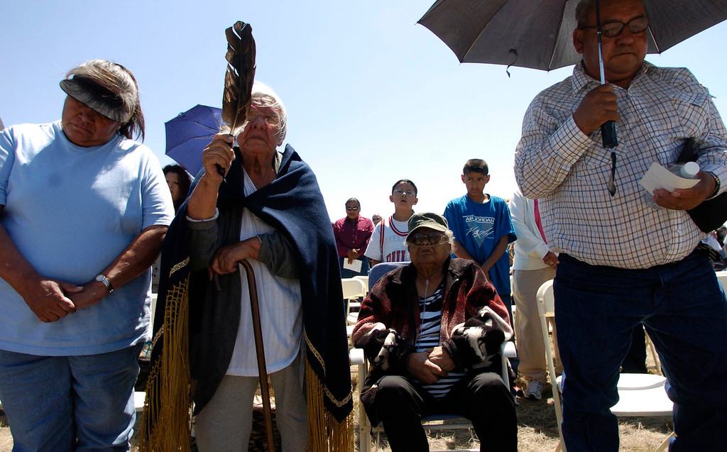 . From left, Elizabeth Yellow Bear, 55, Mary Bear, 80, Mary Underwood, 81, and Edward Underwood, 61, all Arapaho dicendents of the Sand Creek Massacre sing an pray Saturday during the dedication of the Sand Creek Massacre National Historic Site on Saturday, April 28, 2007, 15-miles west of Eads, Colorado.  RJ Sangosti/ The Denver Post