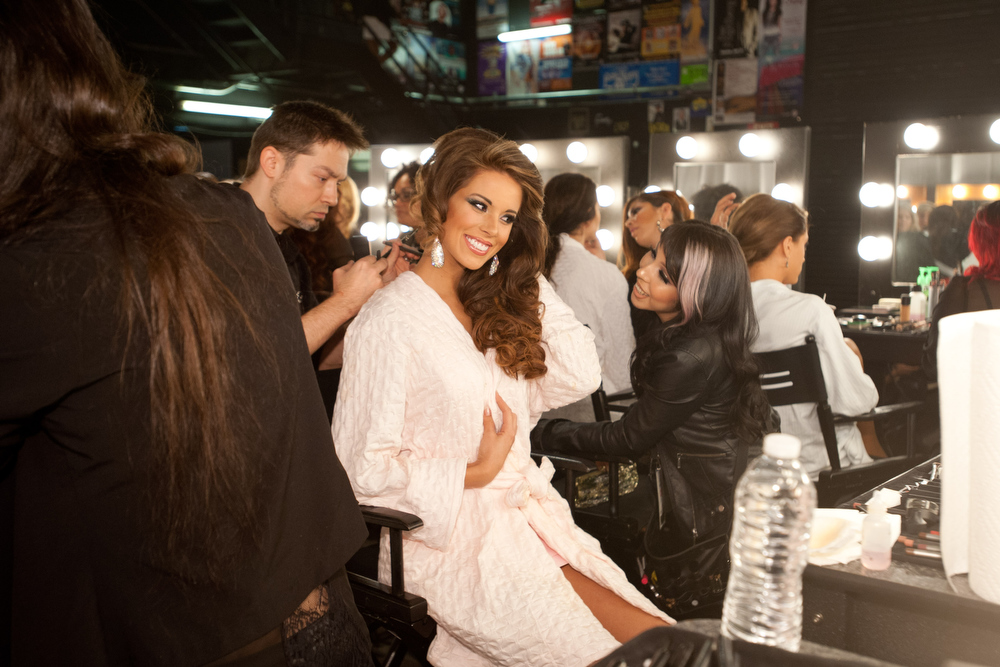 Description of . Miss Spain 2012, Andrea Huisgen, gets her makeup done by MAC artists backstage during the 2012 Miss Universe Presentation Show on Thursday, Dec. 13, 2012 at PH Live in Las Vegas. The 89 Miss Universe Contestants will compete for the Diamond Nexus Crown on December 19.  (AP Photo/Miss Universe Organization L.P., LLLP)