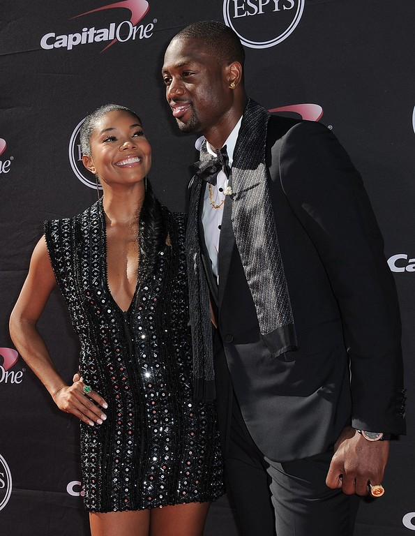 . Actress Gabrielle Union, left, and Miami Heat\'s Dwyane Wade arrive at the ESPY Awards on Wednesday, July 17, 2013, at Nokia Theater in Los Angeles. (Photo by Jordan Strauss/Invision/AP)