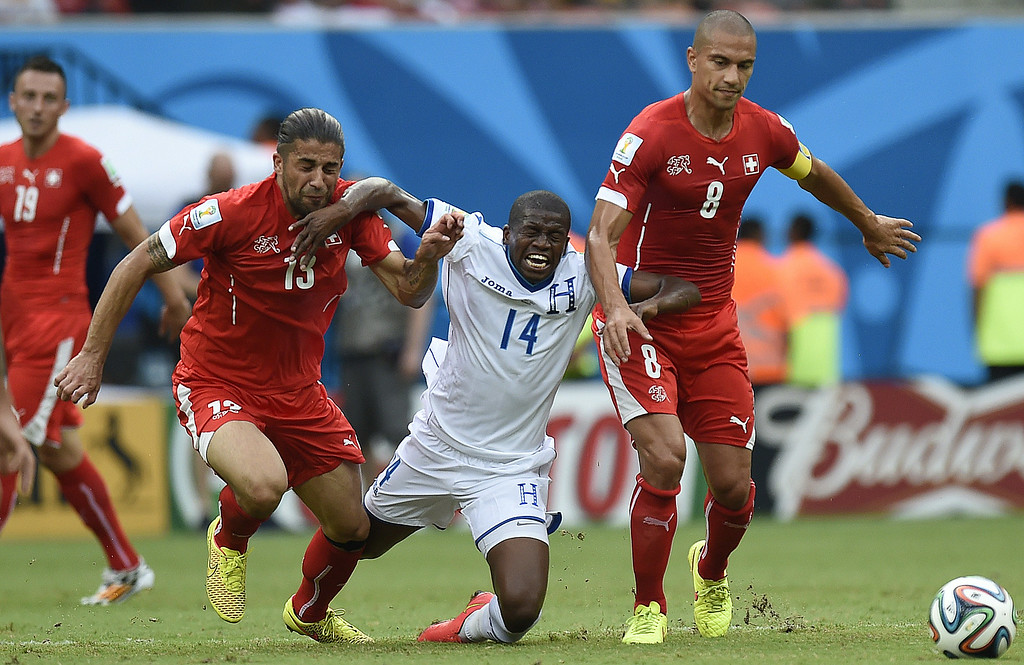 . Honduras\' midfielder Boniek Garcia (L) vies with Switzerland\'s defender Ricardo Rodriguez and Switzerland\'s midfielder and captain Goekhan Inler (R) during a Group E football match between Honduras and Switzerland at the Amazonia Arena in Manaus during the 2014 FIFA World Cup on June 25, 2014. JUAN BARRETO/AFP/Getty Images
