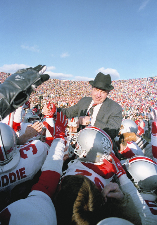 . Ohio State coach Earle Bruce is hoisted above the crowed by his players after the Buckeyes beat Michigan 23-20 in Ann Arbor, Mich., Nov. 21, 1987. Bruce was fired this week after nine years at the helm. (AP Photo/Robert Kozloff)