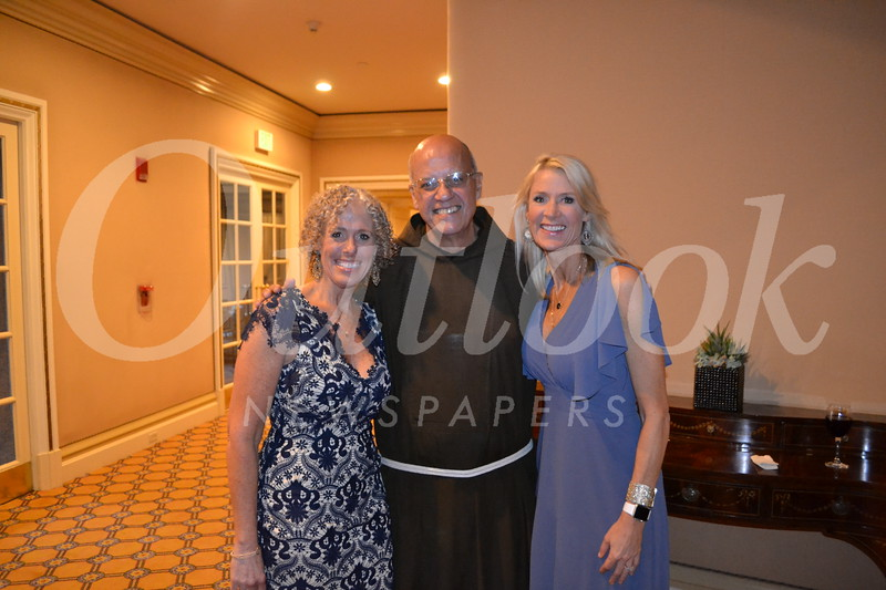 Event co-chairs Christa Durfee and Alicia Lund with St. Francis President Father Tony Marti.