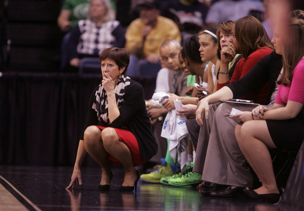 Description of . Notre Dame head coach Muffet McGraw watches her team during the first half a regional semi-final of the NCAA college basketball tournament Sunday March 31, 2013 in Norfolk, Va.  Notre Dame won 93-63. (AP Photo/Jason Hirschfeld)