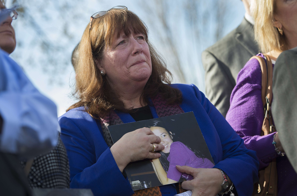 . Daryl Chansuthus, mother of Hasaya, who died in the crash of a 2006 Chevy Cobalt, listens during a press conference with the family members of deceased drivers on Capitol Hill in Washington, DC, April 1, 2014. General Motors Chief Executive Mary Barra faces tough questioning in Congress on Tuesday over why the company ignored a faulty ignition problem for a decade despite numerous accident reports and 13 deaths. Also in the dock will be the US auto safety agency, the National Highway Traffic Safety Administration (NHTSA), under attack for not acting on its own evidence that the ignitions posed dangerous risks to drivers.  (JIM WATSON/AFP/Getty Images)