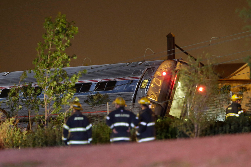 . Emergency personnel work the scene of a train wreck, Tuesday, May 12, 2015, in Philadelphia. An Amtrak train headed to New York City derailed and crashed in Philadelphia. (AP Photo/Matt Slocum)