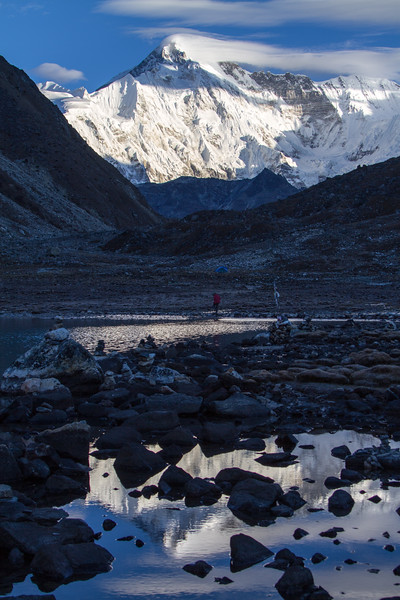 Cho Oyu, the 6th tallest mountain in the world, is seen reflected in the waters of the third lake at Gokyo, Nepal just after sunrise