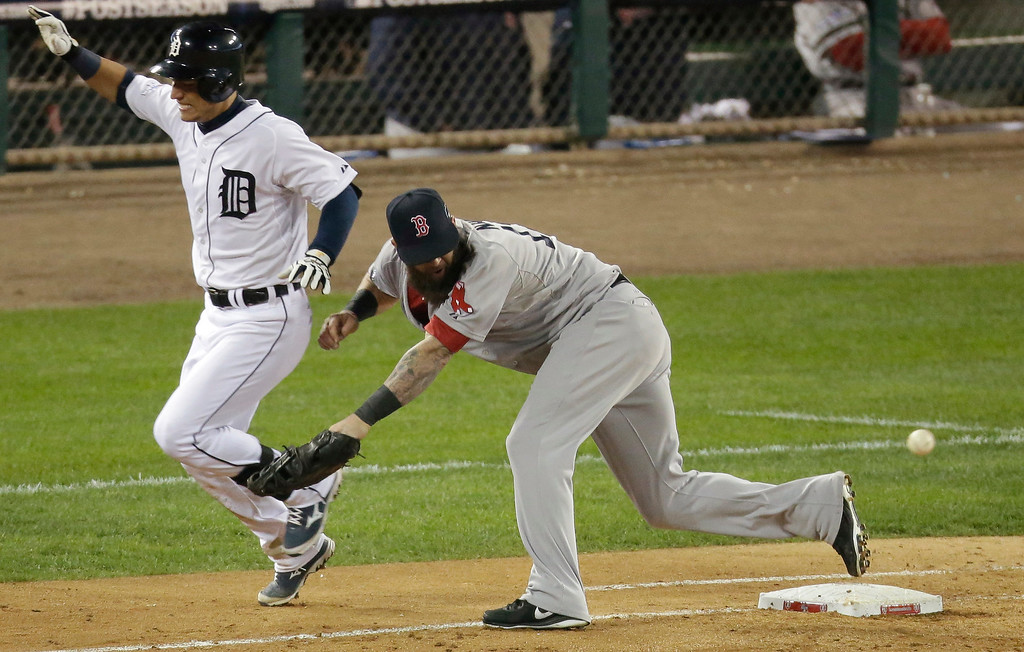 . Detroit Tigers\' Jose Iglesias is safe at first Boston Red Sox\'s Mike Napoli misses the ball in the eighth inning during Game 4 of the American League baseball championship series Wednesday, Oct. 16, 2013, in Detroit. (AP Photo/Charlie Riedel)