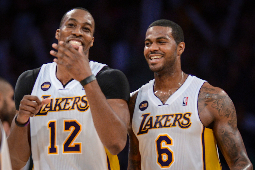 . Lakers\' Dwight Howard and Earl Clark share smiles as the Lakers made a run late in the 4th period to defeat the Spurs 91-86.   Photo by David Crane/L.A. Daily News