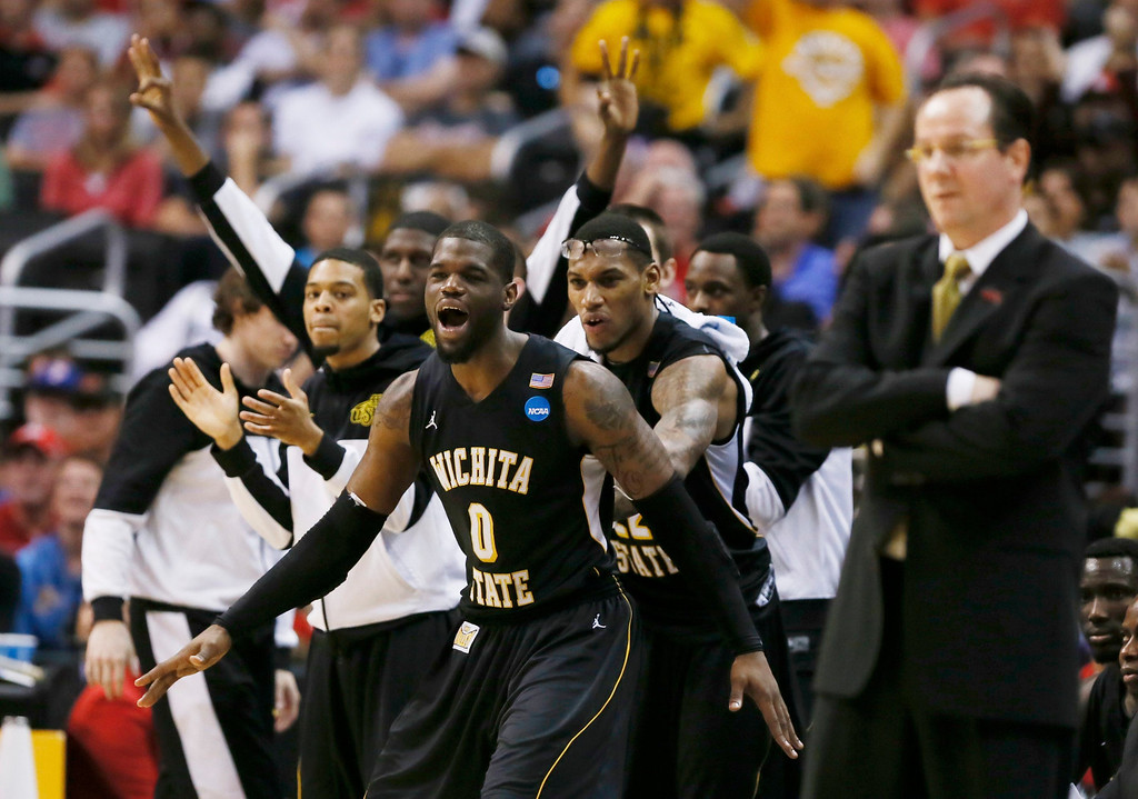 . The Wichita State Shockers bench celebrates their team lead over the Ohio State Buckeyes in the second half during their West Regional NCAA men\'s basketball game in Los Angeles, California March 30, 2013. REUTERS/Lucy Nicholson