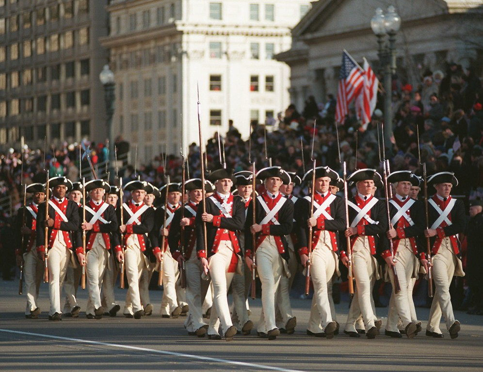 . Members of the Old Guard Fyfe and Drum Corps preceed President Clinton in the presidential inaugural parade on Pennsylvania Avenue in Washington Monday Jan. 20, 1997. (AP Photo/Rick Bowmer)