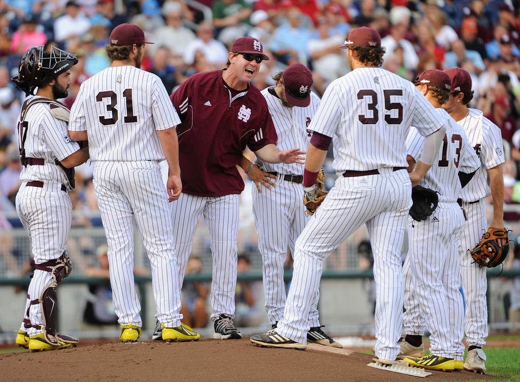 . Mississippi State coach John Cohen, center, addresses his players on the mound after UCLA\'s Kevin Kramer scored in the first inning of Game 1 of the NCAA College World Series best-of-three finals, Monday, June 24, 2013, in Omaha, Neb. Second left is starting pitcher Trevor Fitts, and third right is first baseman Wes Rea (35). (AP Photo/Francis Gardler)