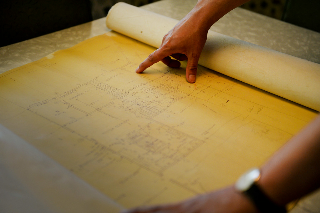 . Redlands resident Nathan Gonzales lays out the original blueprints of his home on Thursday, July 10, 2014 in Redlands, Ca. Gonzales\' home was added to the city�s historic register list and is the second post-World War II era building added to it. (Photo by Micah Escamilla/Redlands Daily Facts)