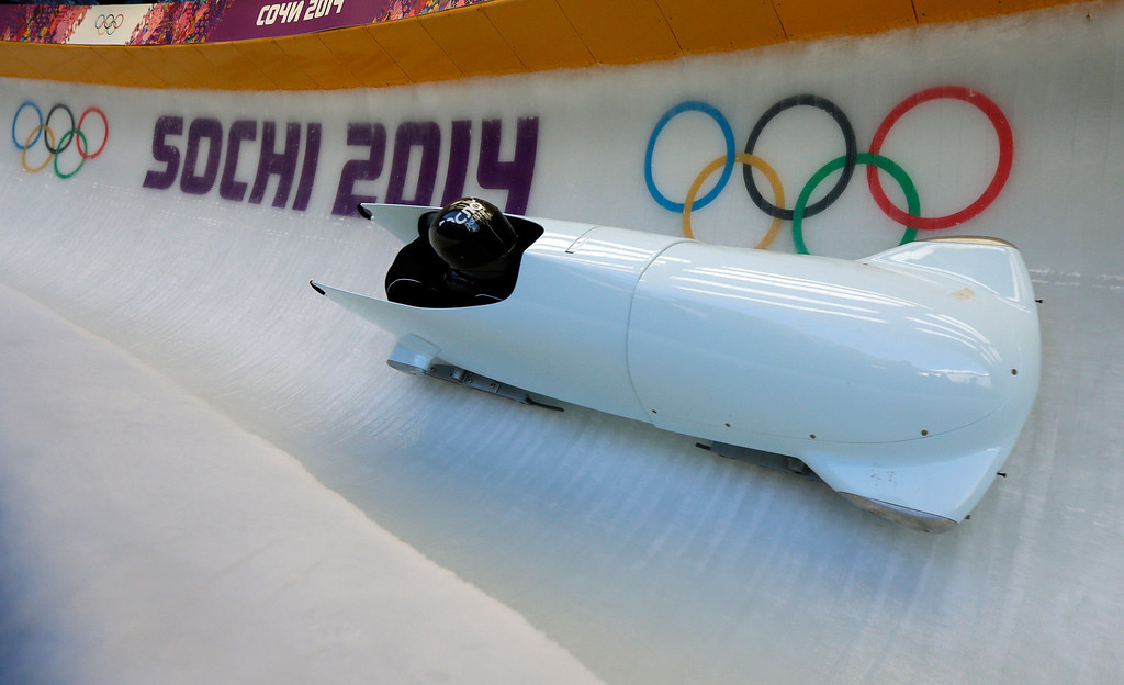 . A forerunner bobsled goes down the track in turn five just before the start of the men\'s two-man bobsled training at the 2014 Winter Olympics, Thursday, Feb. 13, 2014, in Krasnaya Polyana, Russia. The forerunner sled hit a track worker in a lower turn in this run causing serious injuries.  (AP Photo/Natacha Pisarenko)