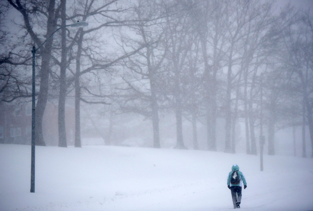 . A pedestrian walks through snow in Parkville, Md., Saturday, Jan. 23, 2016. One in seven Americans will get at least half a foot of snow outside their homes when this weekend\'s big storm has finished delivering blizzards, gale-force winds, whiteout conditions and flooding to much of the eastern United States. (AP Photo/Steve Ruark)
