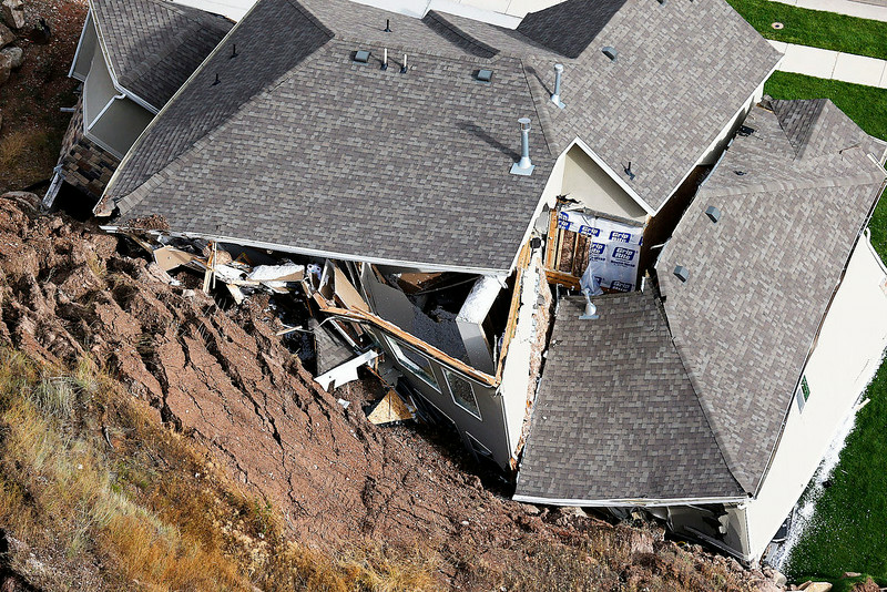 . A home is destroyed following a landslide in a hillside community of North Salt Lake, Utah, Tuesday, Aug. 5, 2014. At least a dozen other homes have been evacuated.  (AP Photo/The Deseret News, Ravell Call)