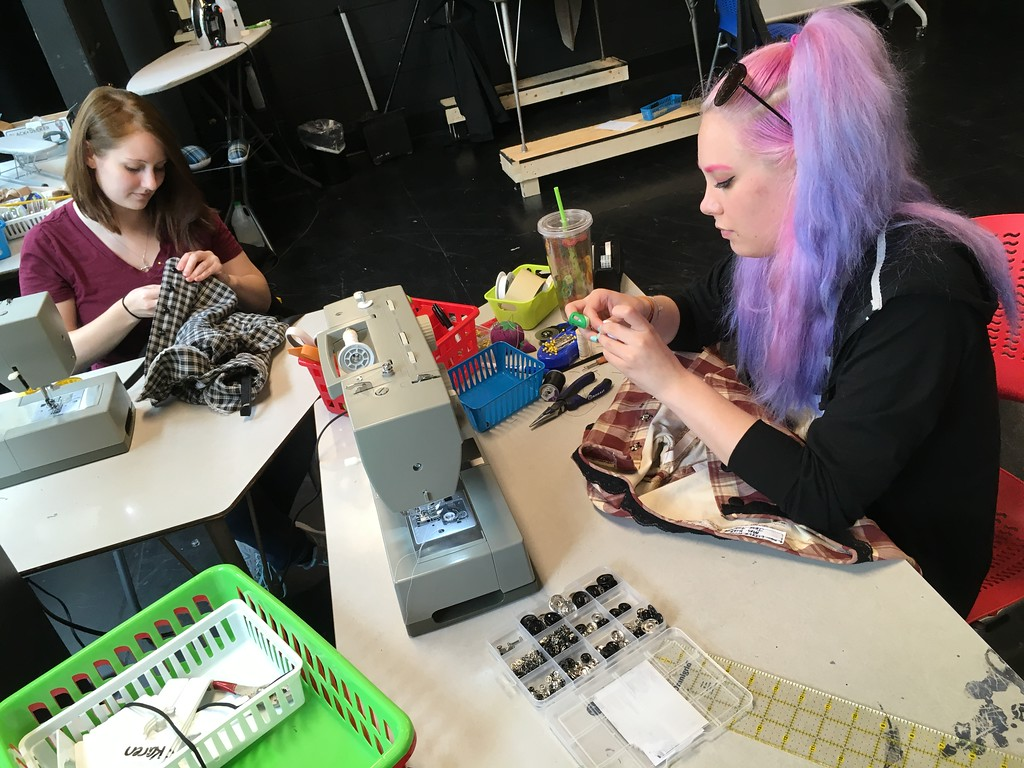 ". Richard Payerchin � The Morning Journal <br> Susanna Bordelon, left, a student of University of Wisconsin-Stout, and Bridget Kline, a student at Baldwin Wallace University, sew costumes for ""Little Women,\"" the play that opened the Oberlin Summer Theater Festival. The festival has grown to 50 employees, including some from outside Ohio, for the program with three free plays running from June to August each year."