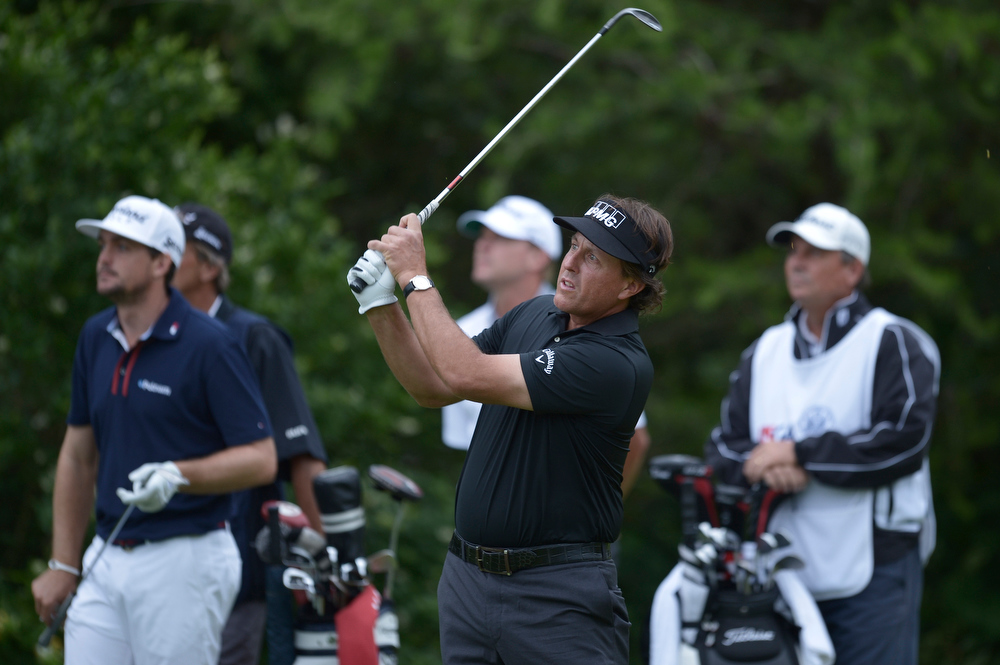 . Phil Mickelson of United States watches a drive on the 12th hole during the first round the US Open at Merion Golf Club June 13, 2013 in Ardmore, Pennsylvania.  BRENDAN SMIALOWSKI/AFP/Getty Images