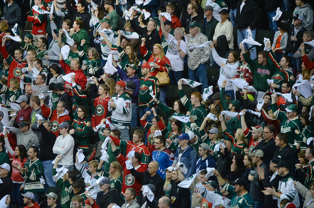 . Minnesota fans cheered lustily with the expectation of a win late in the third period.   (Photo by Karl Gehring/The Denver Post)