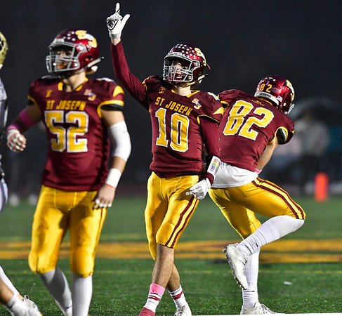 12/14/2019 Mike Orazzi | Staff St. Joseph High School's Austin Jose (10) celebrates a field goal during a 17-13 win over Daniel Hand at Veteran's Stadium in New Britain on Saturday.