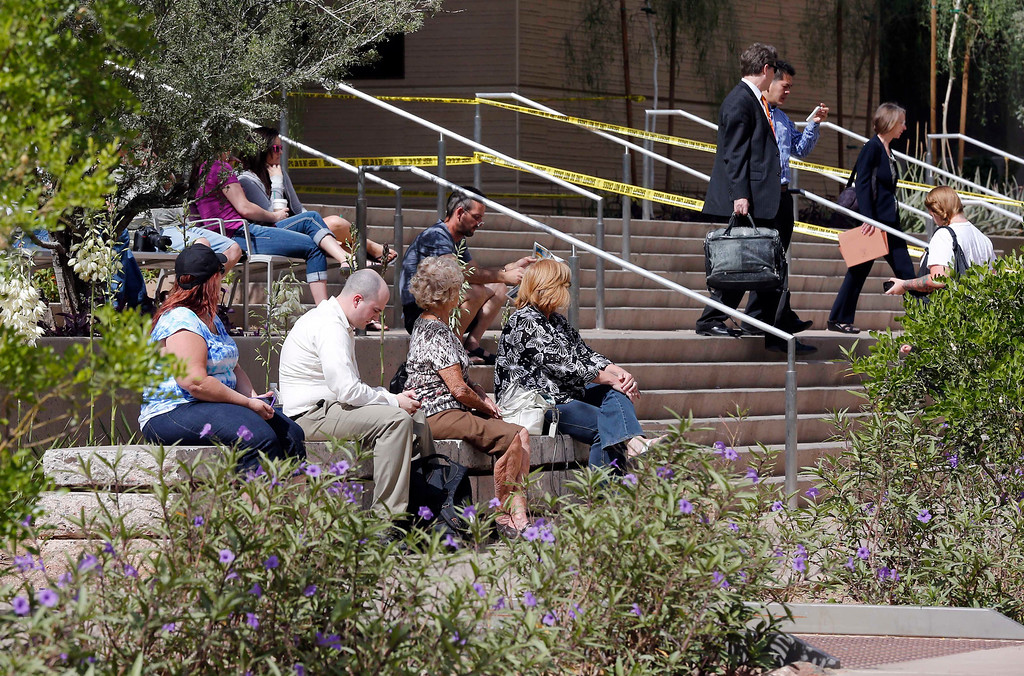 . People gather outside Superior Court, Wednesday, May 8, 2013 in downtown Phoenix. Jurors reached a verdict Wednesday in the trial of Jodi Arias, who is accused of murdering her one-time boyfriend in Arizona. 