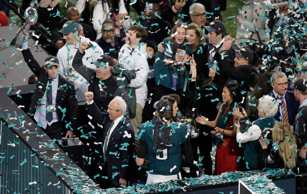 . Philadelphia Eagles owner Jeffrey Lurie, bottom left, raises his fist after the NFL Super Bowl 52 football game against the New England Patriots, Sunday, Feb. 4, 2018, in Minneapolis. The Eagles won 41-33. (AP Photo/Eric Gay)