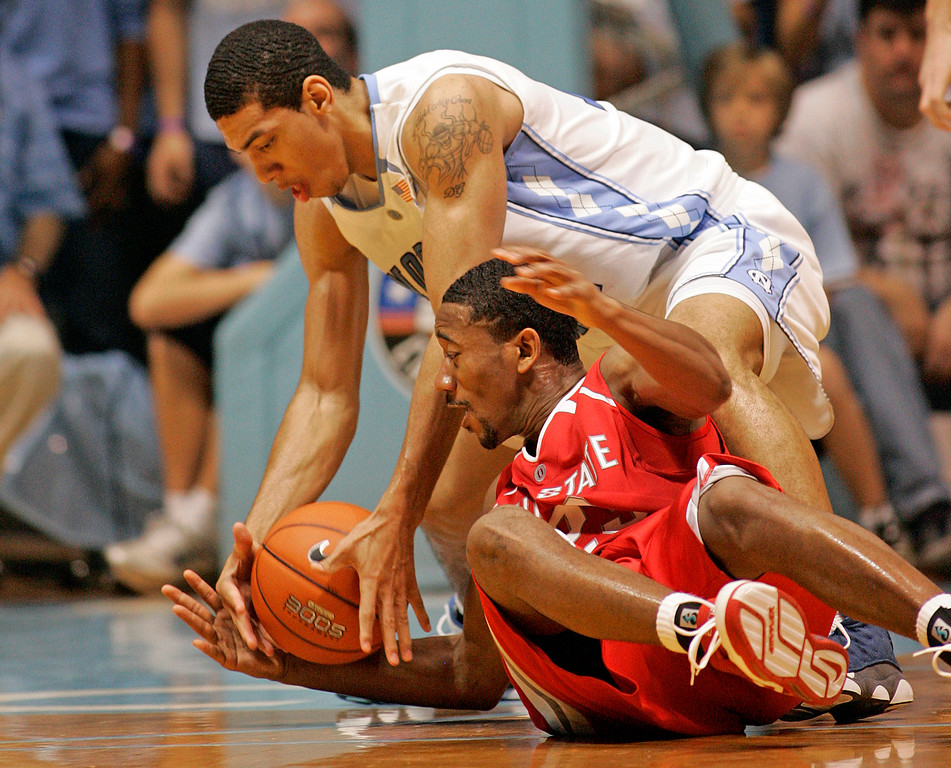 . Ohio State\'s David Lighty, bottom, battles North Carolina\'s Danny Green during the first half of a college basketball game in Chapel Hill, N.C., Wednesday, Nov. 29, 2006. (AP Photo/Karl DeBlaker)
