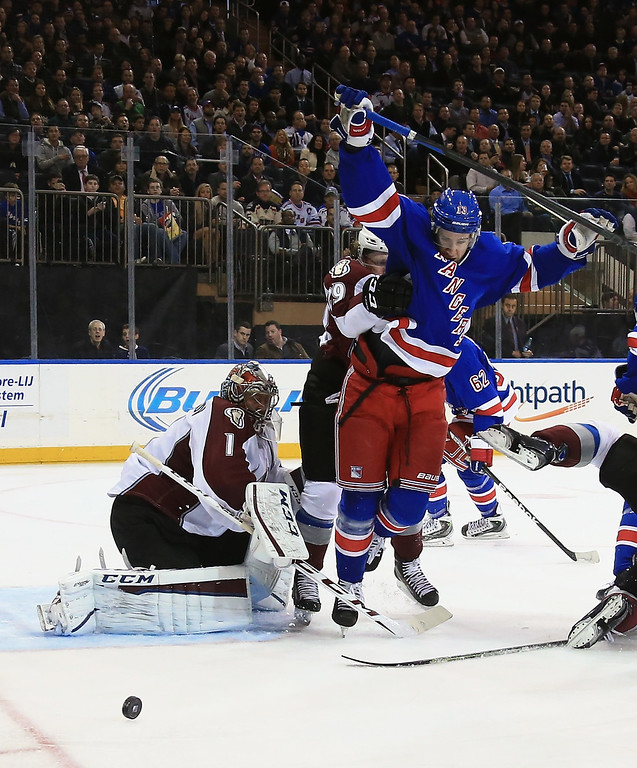 . NEW YORK, NY - NOVEMBER 13: Kevin Hayes #13 of the New York Rangers is pushed out of the way as Semyon Varlamov #1 of the Colorado Avalanche makes the second period save at Madison Square Garden on November 13, 2014 in New York City.  (Photo by Bruce Bennett/Getty Images)