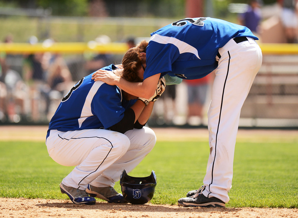 . DENVER, CO. - MAY 24 :Trevor Minner (20), right, comforts Reece Weber (33) of Grandview High School  after losing semifinal round of 5A State Championships baseball game against Rocky Mountain High School at All City Field. Denver, Colorado. May 24, 2013. Rocky Mountain won 8-6. (Photo By Hyoung Chang/The Denver Post)