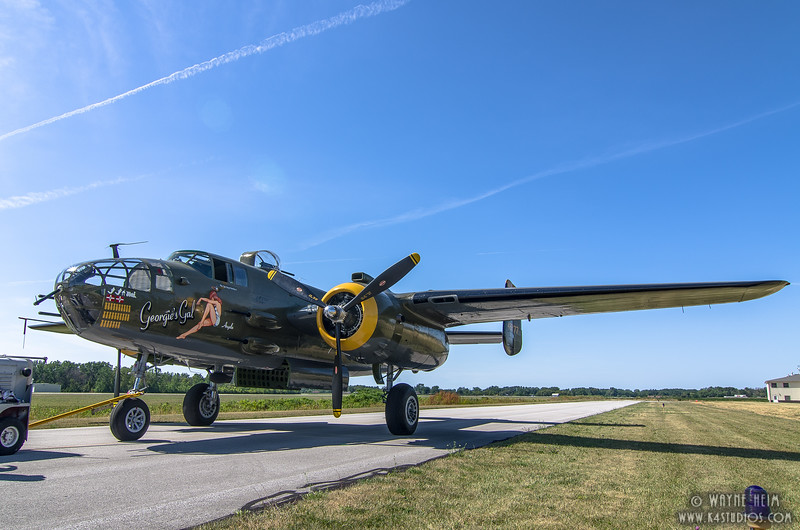 Towing the Plane  Photography by Wayne Heim