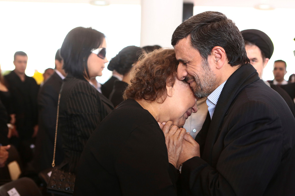 . Iran\'s President Mahmoud Ahmadinejad (R) offers his condolences to Elena Frias, mother of Venezuela\'s late President Hugo Chavez, during the funeral service at the Military Academy in Caracas March 8, 2013, in this picture provided by the Miraflores Palace. REUTERS/Miraflores Palace/Handout