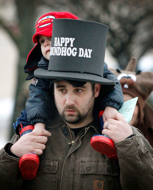 . Paul Porter, from Parkersburg, W.Va. gives his three-year-old son, Peyton, a ride on his shoulders as they visit Punxsutawney, Pa. on Tuesday, Feb. 1, 2011. Thousands of people are gathering in the small Pennsylvania town in anticipation of the annual gathering at Gobblers Knob for Groundhog Day. (AP Photo/Keith Srakocic)