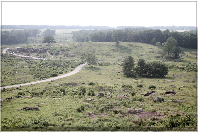 A view from Little Round Top looking across to Devil's Den on a hazy summer day.