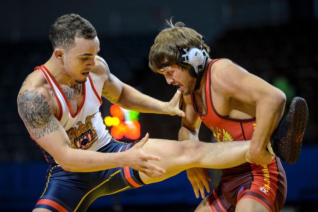 . Russian Rasul Dzhukaev and the US\'s Jordan Oliver, left, during their match at the USA vs Russia vs Canada dual meet at the Sports Arena Sunday .  Photo by David Crane/Los Angeles Daily News.