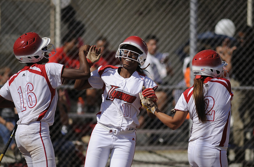 . LONG BEACH, CALIF. USA -- Lakewood\'s Tyler Burke (11) celebrates her two-run homer in the second inning against WIlson with teammates Jessica Scroggins (16) and Alex Carillo (2) in Lakewood, Calif., on May 2, 2013. Burke\'s home run was the winning run in their 11-1 victory.  Photo by Jeff Gritchen / Los Angeles Newspaper Group