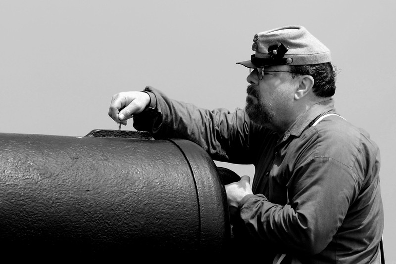Reenactor Private George Bragdon inserts the friction primer to prepare the Model 1841 32-pound Smooth Bore canon for firing at Ft. Moultrie in Sullivan's Island, South Carolina on Monday, April 11, 2011. ..The 150th Anniversary of the Firing on Ft. Sumter was commemorated with lectures, performances, demonstrations, and a living history throughout the area on James Island, Charleston, Mt. Pleasant, and Sullivan's Island during the week from April 8-14, 2011. Photo Copyright 2011 Jason Barnette