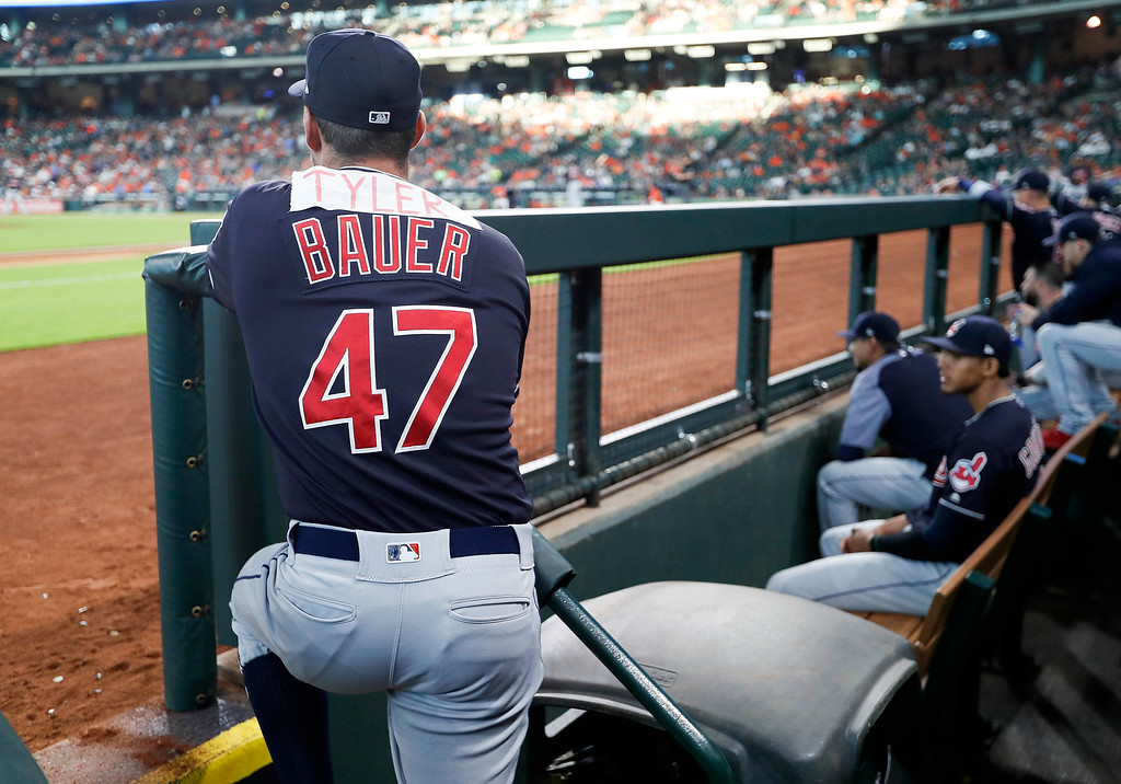 ". Cleveland Indians pitcher Trevor Bauer (47) watches from the dugout with the name ""Tyler\"" on the back of his jersey during the first inning of a baseball game against the Houston Astros, Friday, May 18, 2018, in Houston. \""Tyler\"" was in reference to Houston Astros\' Alex Bregman response to Bauer\'s suggestions of cheating by Astros pitchers via Twitter on May 1. Bregman called Bauer \""Tyler.\"" (AP Photo/Eric Christian Smith)"