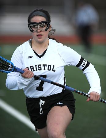 4/11/2018 Mike Orazzi | Staff Bristol Co-op lacrosse's Maddie Bourassa (7) at Bristol Central Wednesday.